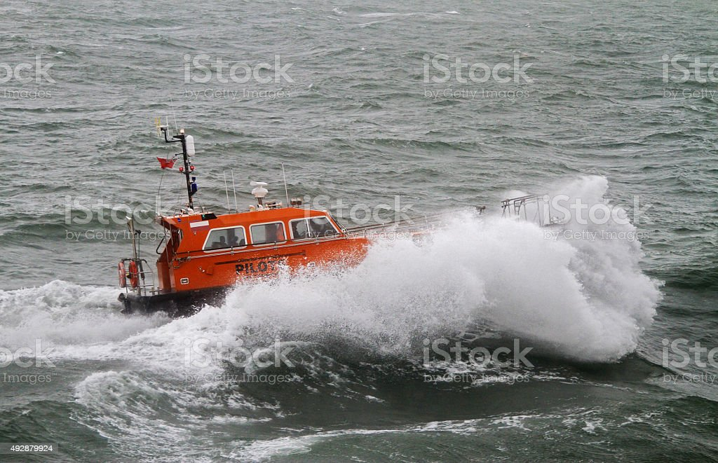 Pilot Boat Swell A British Pilot Boat fights through a heavy swell to reach its offshore rendezvous 2015 Stock Photo
