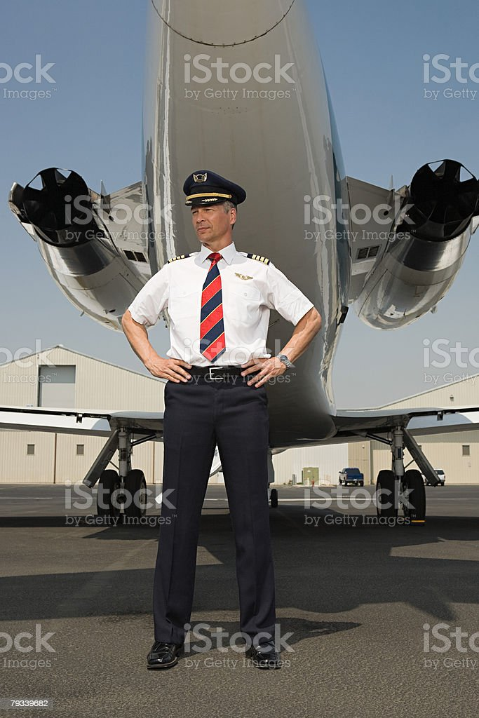 Pilot by private airplane stock photo