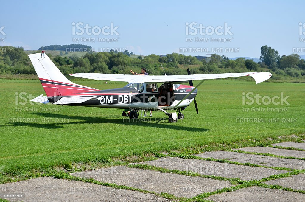 Pilot check his airplane before taking off stock photo