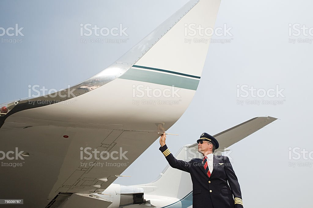 Pilot checking aircraft 免版稅 stock photo