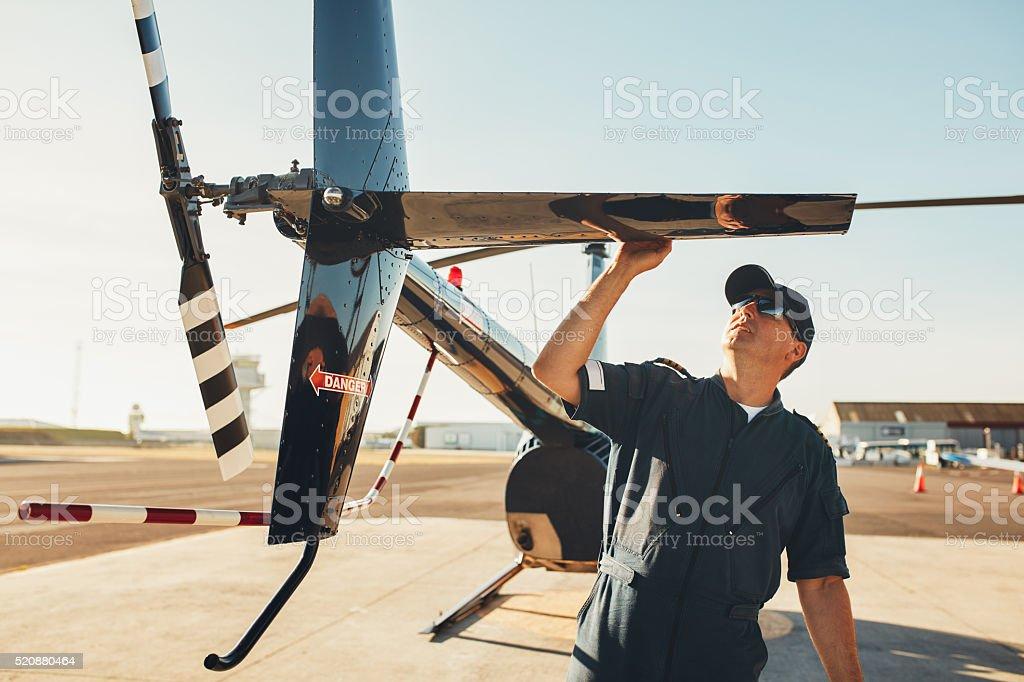 Pilot doing pre flight inspection stock photo