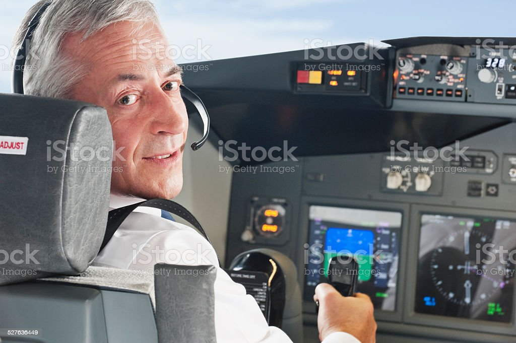 Pilot driving airplane in cockpit stock photo