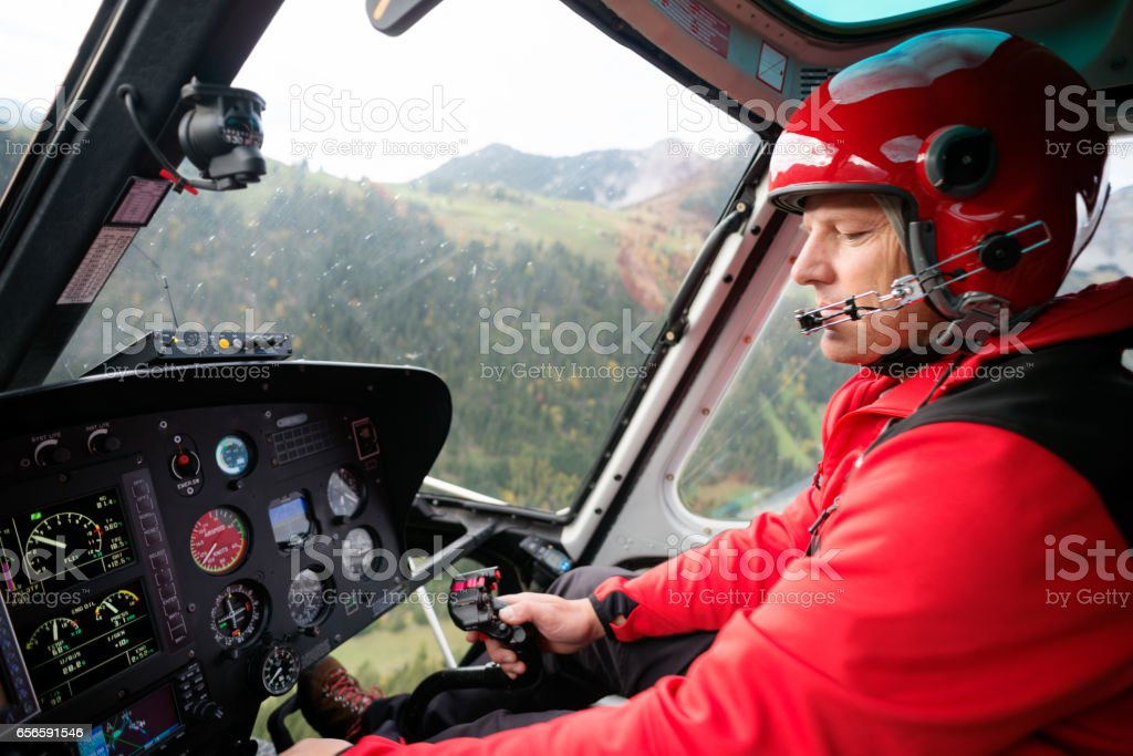 Pilot Flies Mountain Rescue Helicopter stock photo