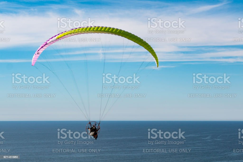 Pilot Flies with a Motorized Paraglider Near Torrey Pines Gliderport stock photo