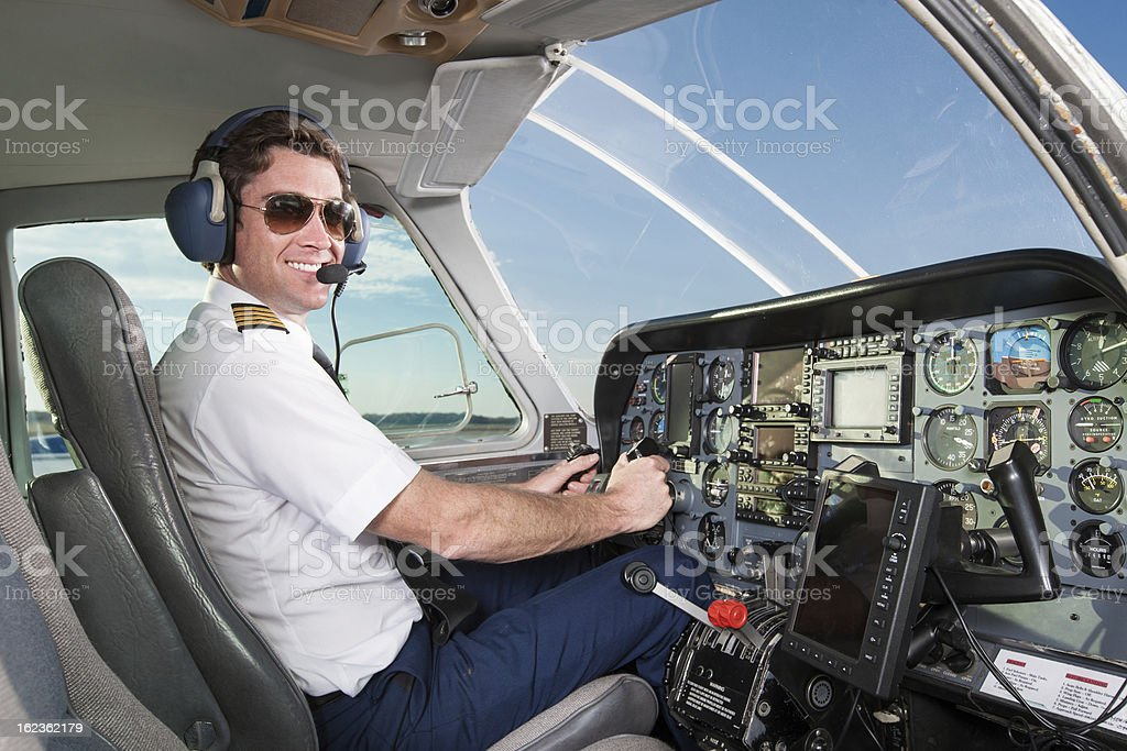 Pilot Flying Small Commuter Airplane royalty-free stock photo