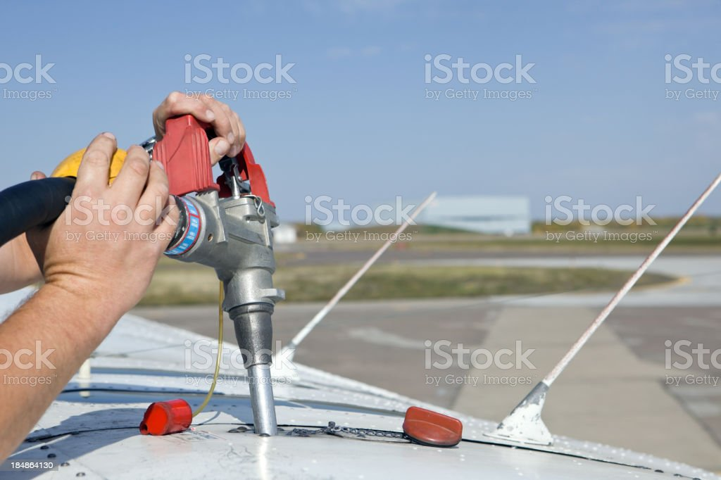 Pilot Fueling Small Private Airplane Wing Tank royalty-free stock photo