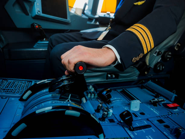 A Pilot hand is controlling plane to fly take off and landing A Pilot hand is controlling plane to fly take off and landing pilot stock pictures, royalty-free photos & images