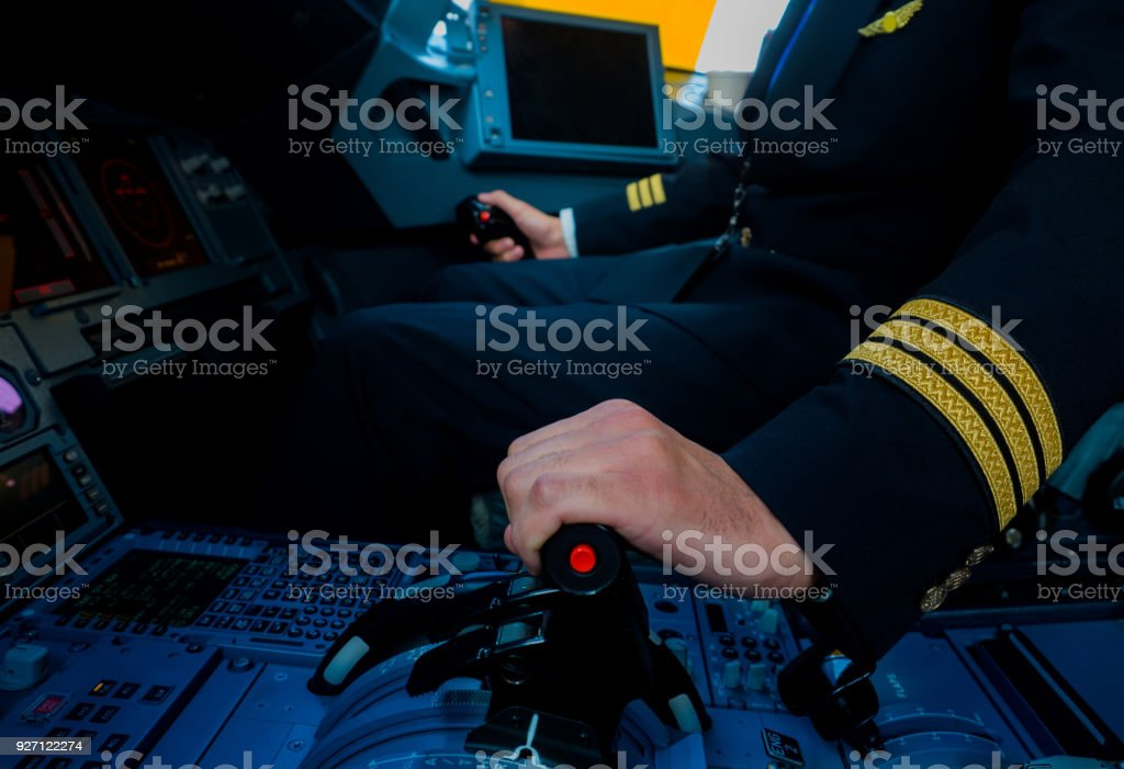 A Pilot hand is controlling plane to fly take off and landing stock photo