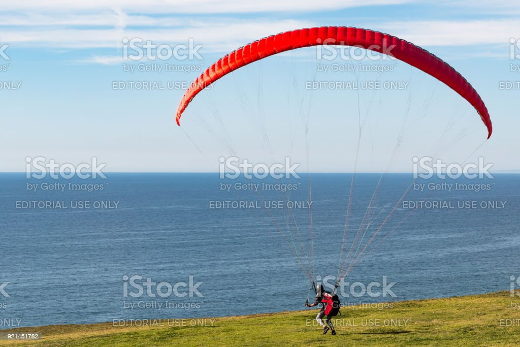 Pilot Heads Toward Edge of Cliff at Torrey Pines Gliderport stock photo