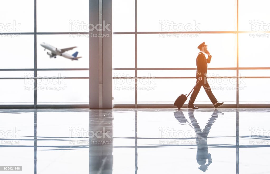 Pilot in airport stock photo