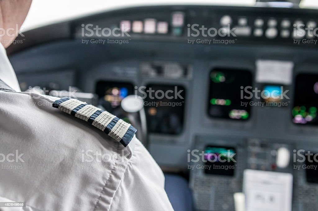 Pilot in cockpit stock photo