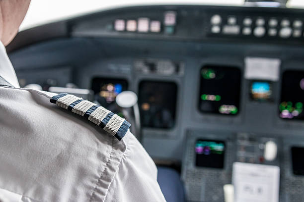 pilot in cockpit - pilot stock photos and pictures