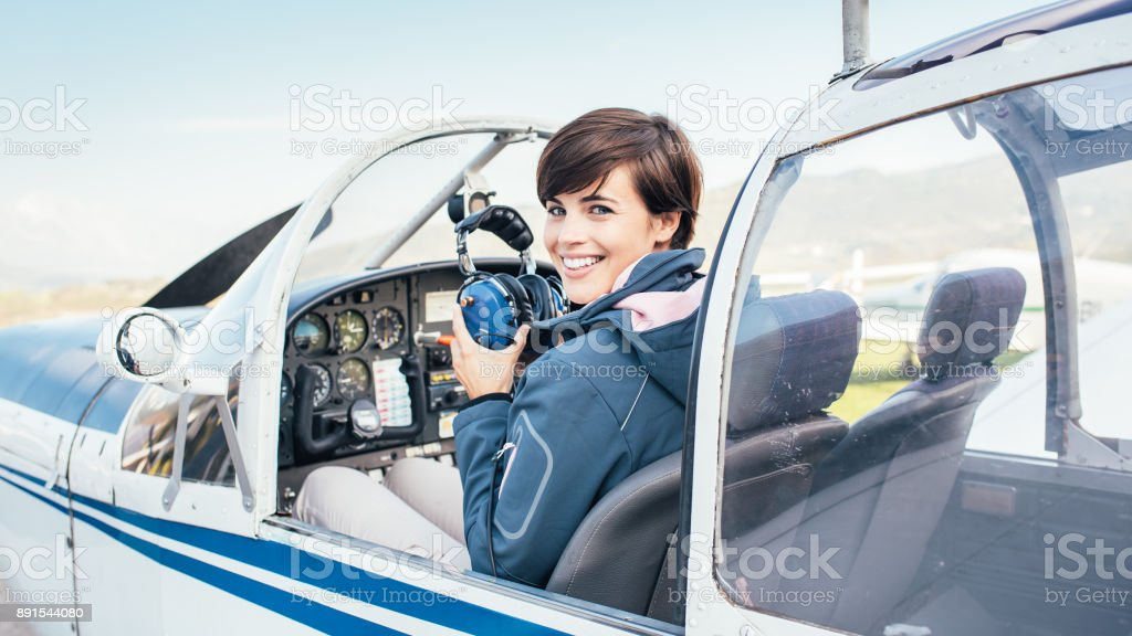 Pilot in the aircraft cockpit stock photo