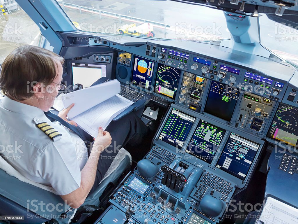 Pilot in the Cockpit of a Commercial Jet stock photo
