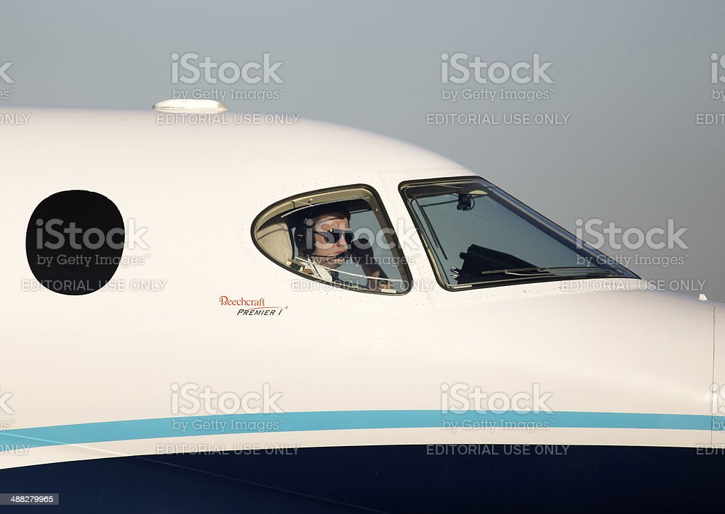 Pilot in the cockpit of the private jet royalty-free stock photo