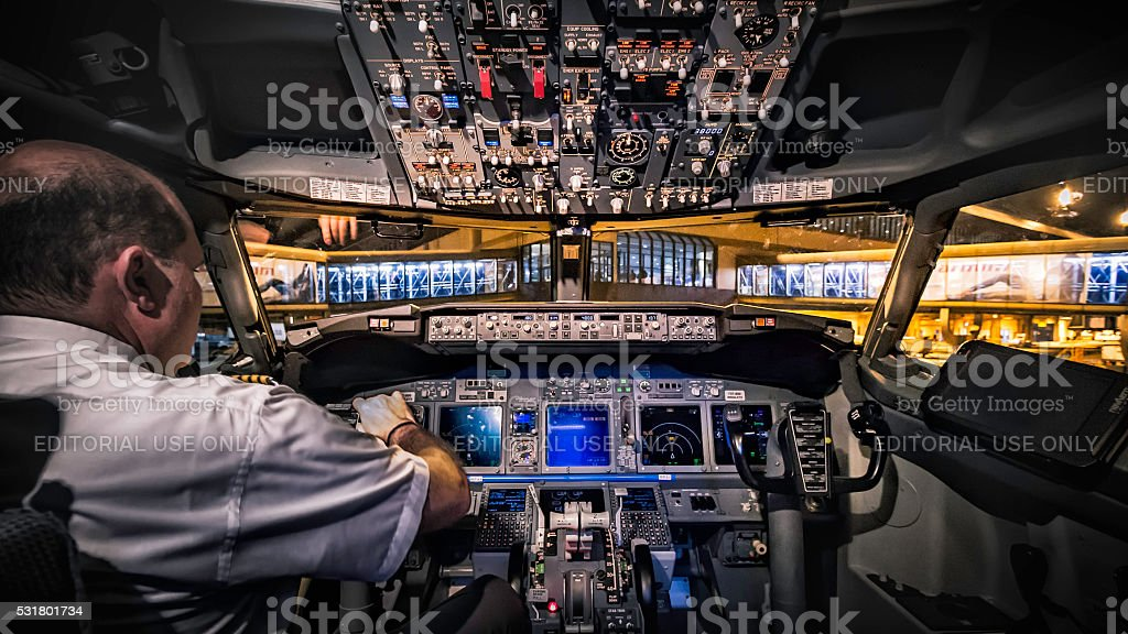 Pilot in the cockpit stock photo