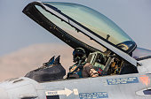 Pilot in the cocpit of an F-16 fighter jet plane.