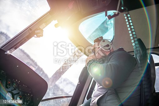 Pilot inside a helicopter cockpit. Preflight check.