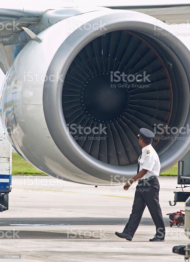 A pilot inspecting a plane before slight stock photo