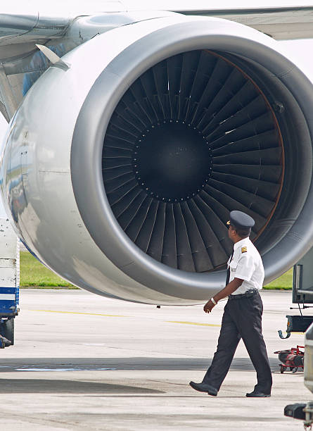 A pilot inspecting a plane before slight stock photo