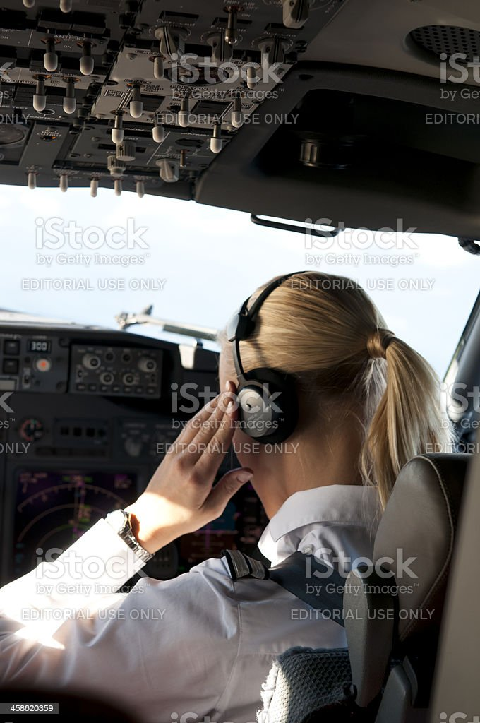 Pilot Listens To New Information From Control Center stock photo