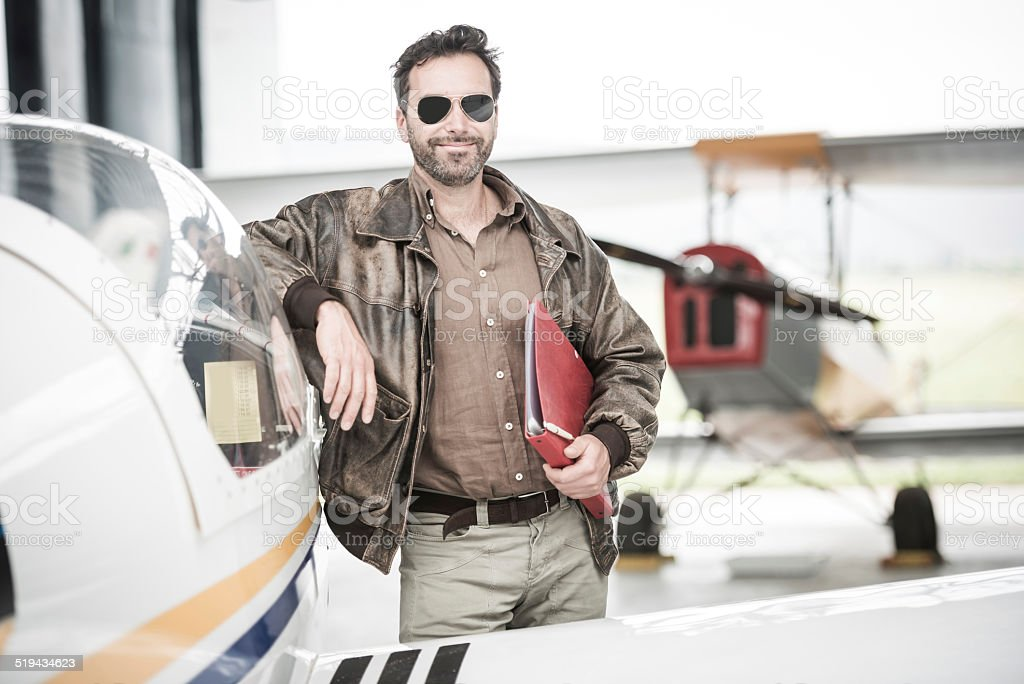 Pilot Next To His Airplane stock photo