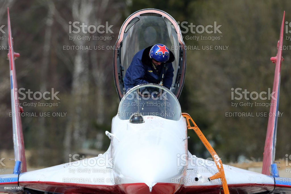 Pilot of Mikoyan-Gurevich MiG-29 of Swifts aerobatics team of Russian air force during Victory Day parade rehearsal at Kubinka air force base. stock photo