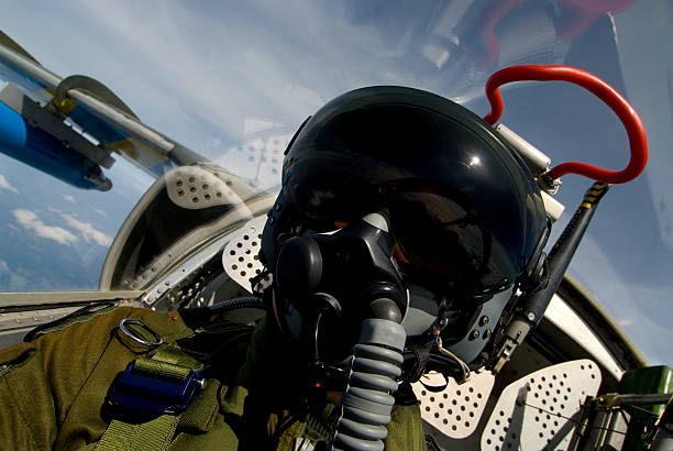 Pilot A pilot in his aircraft air force stock pictures, royalty-free photos & images