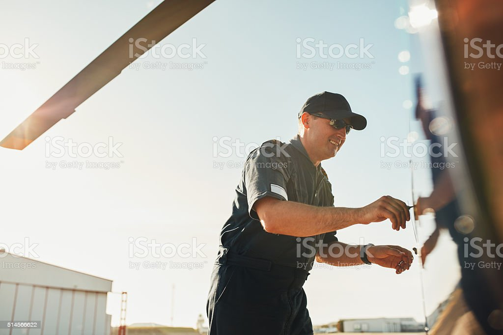 Pilot preparing his helicopter for flight stock photo