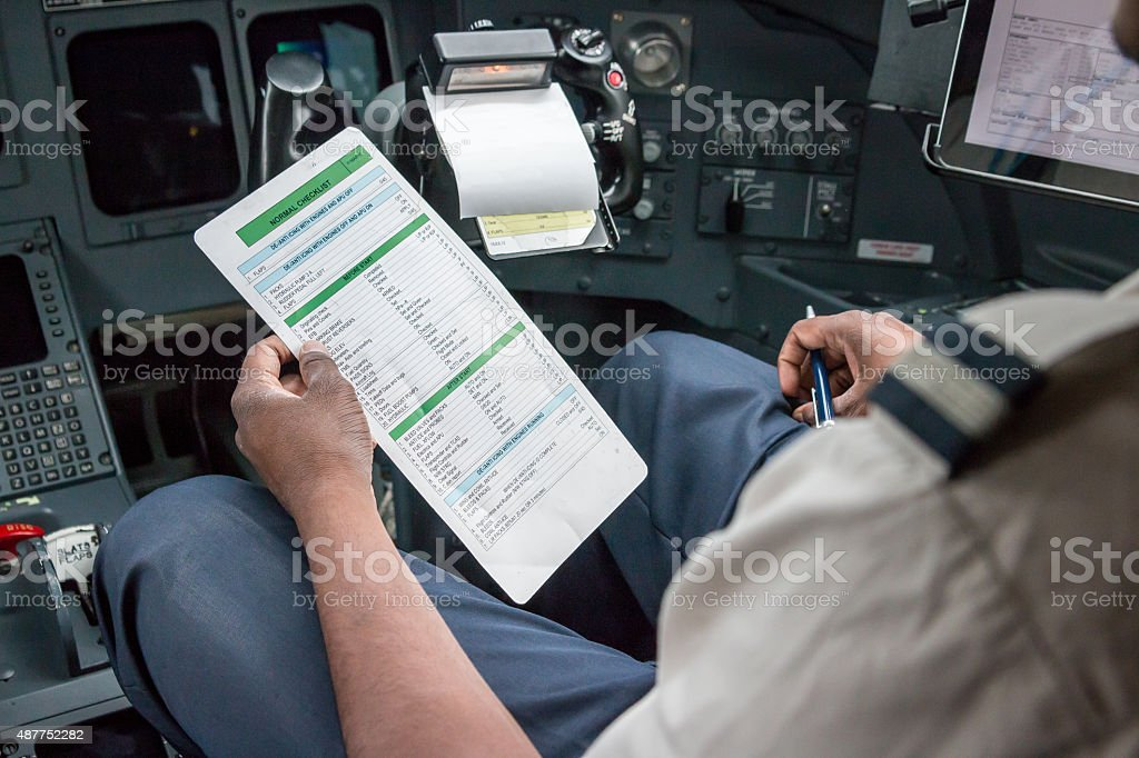 Pilot reading checklist stock photo