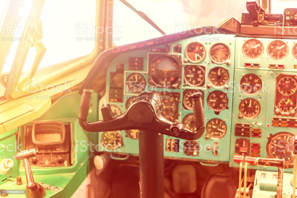 pilot seat in the old plane. Steering wheel and control panel in the cockpit, toned stock photo