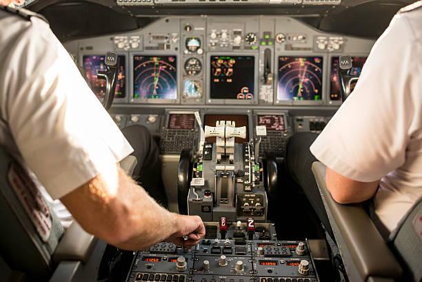 Pilot setting up instruments stock photo
