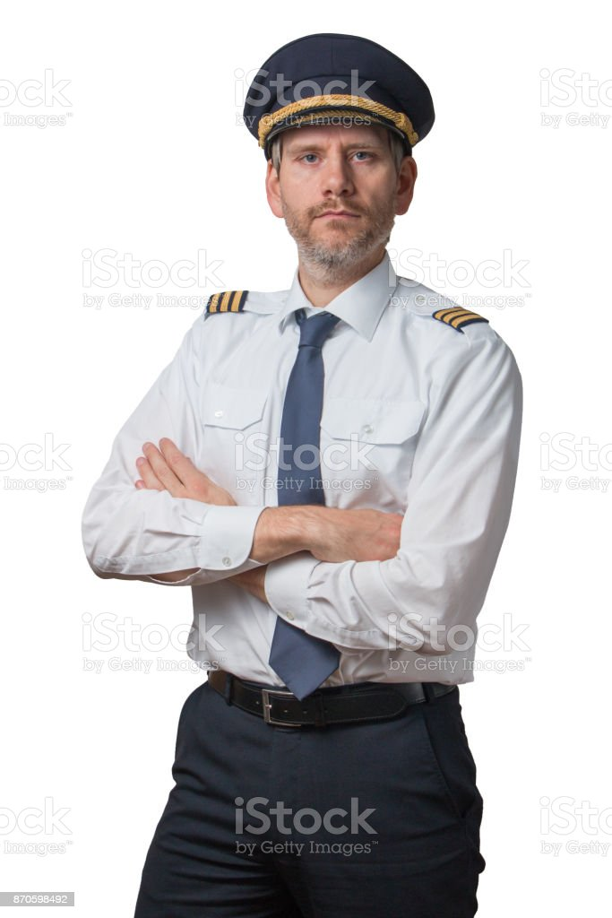 Pilot standing with arms crossed stock photo