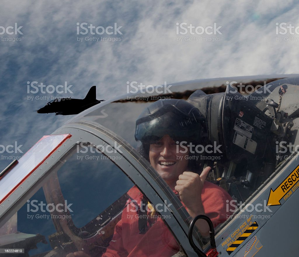 A pilot taking a selfie inside a fighter jet stock photo