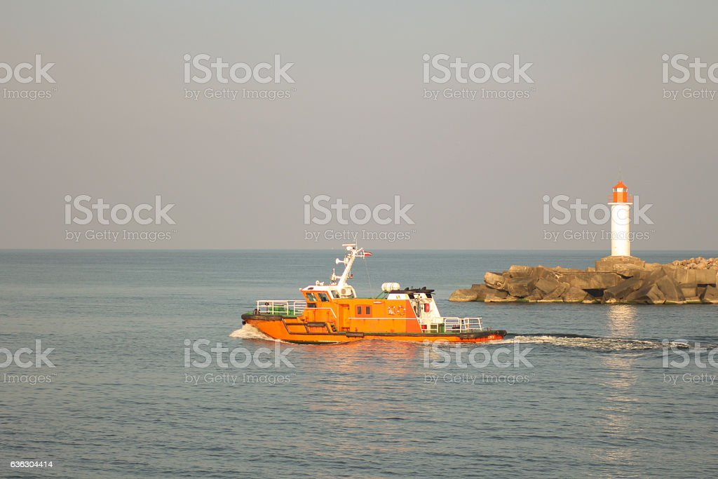 Pilot vessel leaving the port of Ventspils stock photo