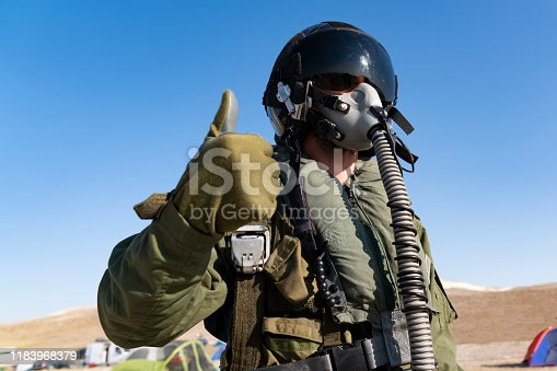 istock Pilot with suit and military air. Fighter pilot portrait posing 1183968379
