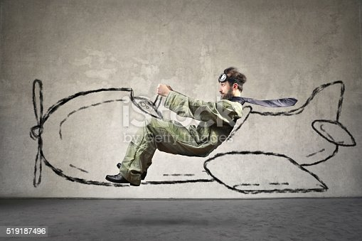 620402800istockphoto Piloting man 519187496