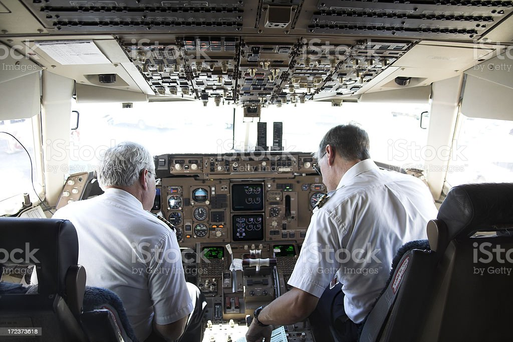 Pilots at work series stock photo