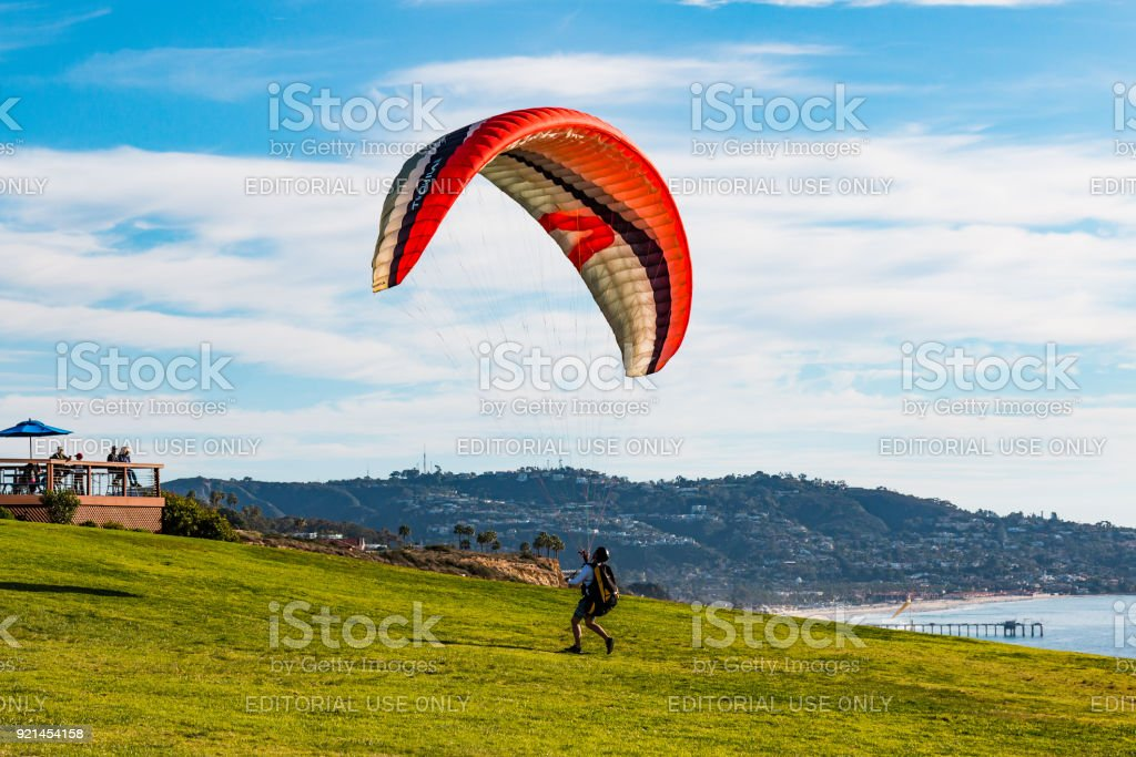 Pilots Attempts to Launch Paraglider at Torrey Pines Gliderport stock photo