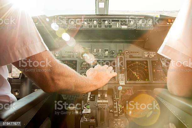 Captain is starting increasing thrust to take off. Departure is during sunset.