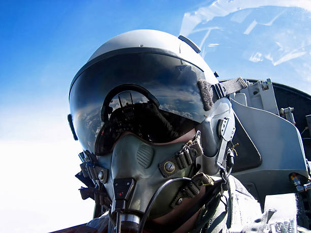 Pilot's Face A fighter Pilot's self portrait ..ahem, thats me. Zoom into the visor, and see the cockpit and the hand taking the shot. fighter plane stock pictures, royalty-free photos & images