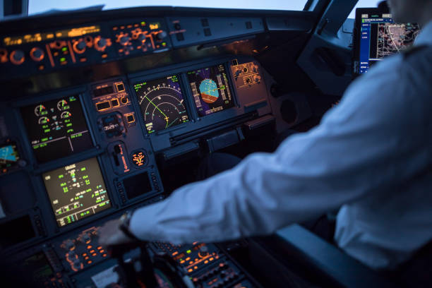 Pilot's hand accelerating on the throttle in  a commercial airliner airplane flight cockpit during takeoff Pilot's hand accelerating on the throttle in  a commercial airliner airplane flight cockpit during takeoff passenger cabin stock pictures, royalty-free photos & images