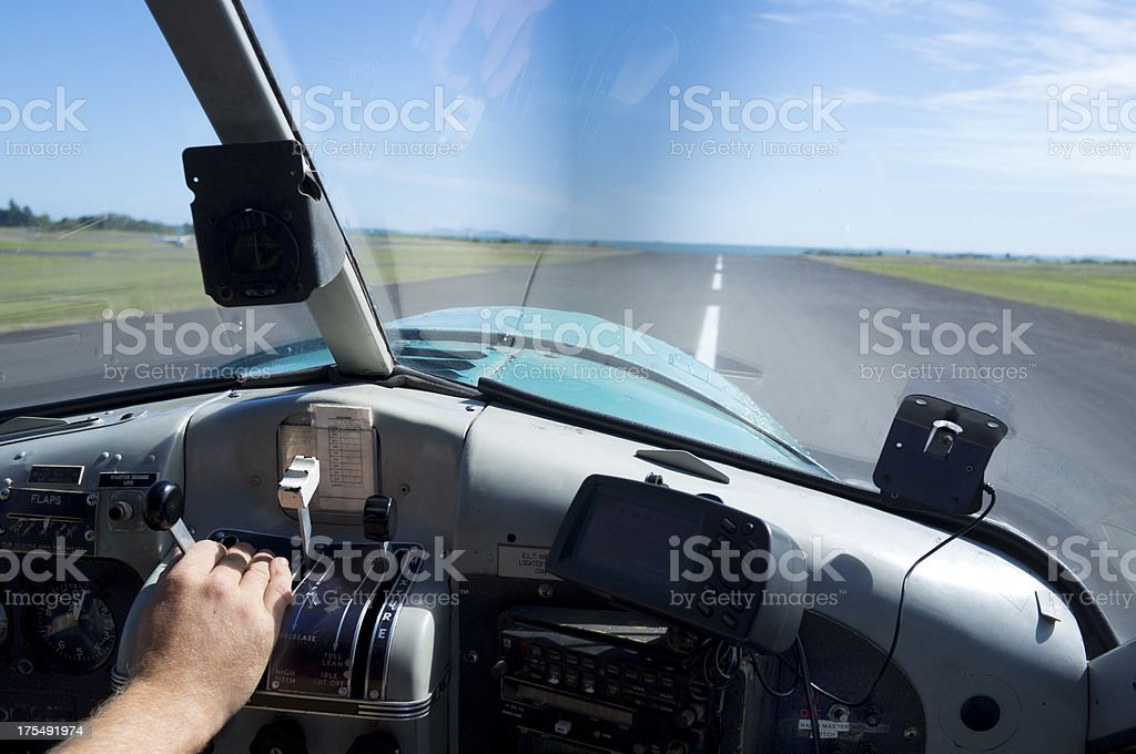 Pilots hand during take off in a small airplane stock photo