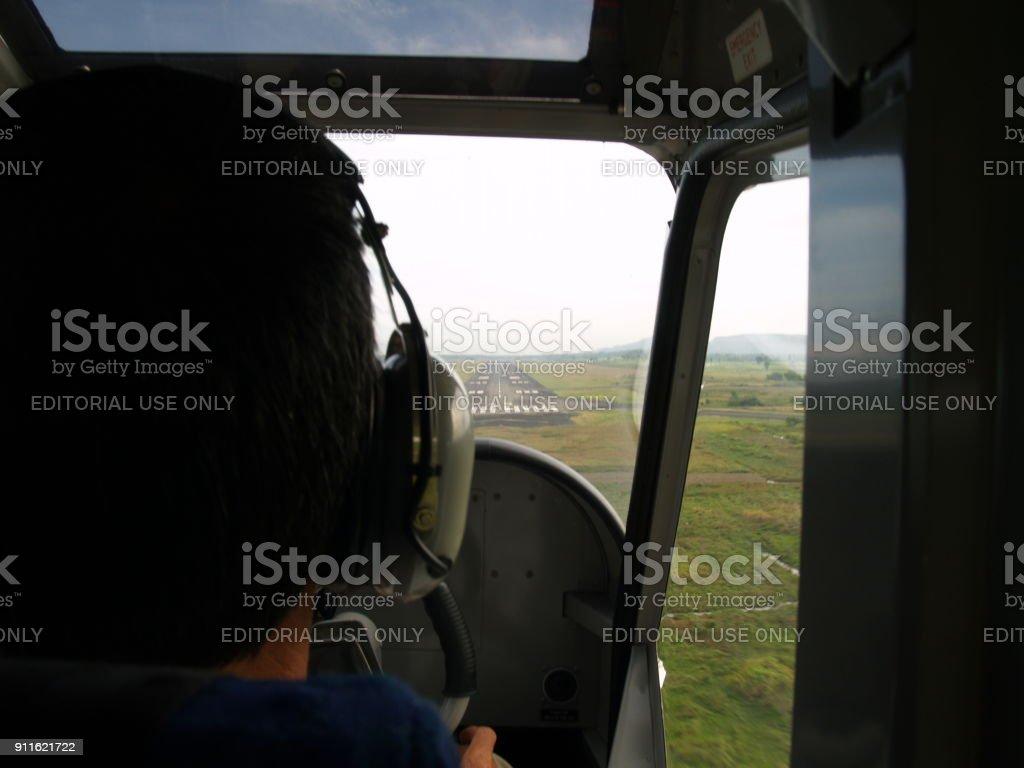 Pilots in Cockpit Prepare for landing stock photo
