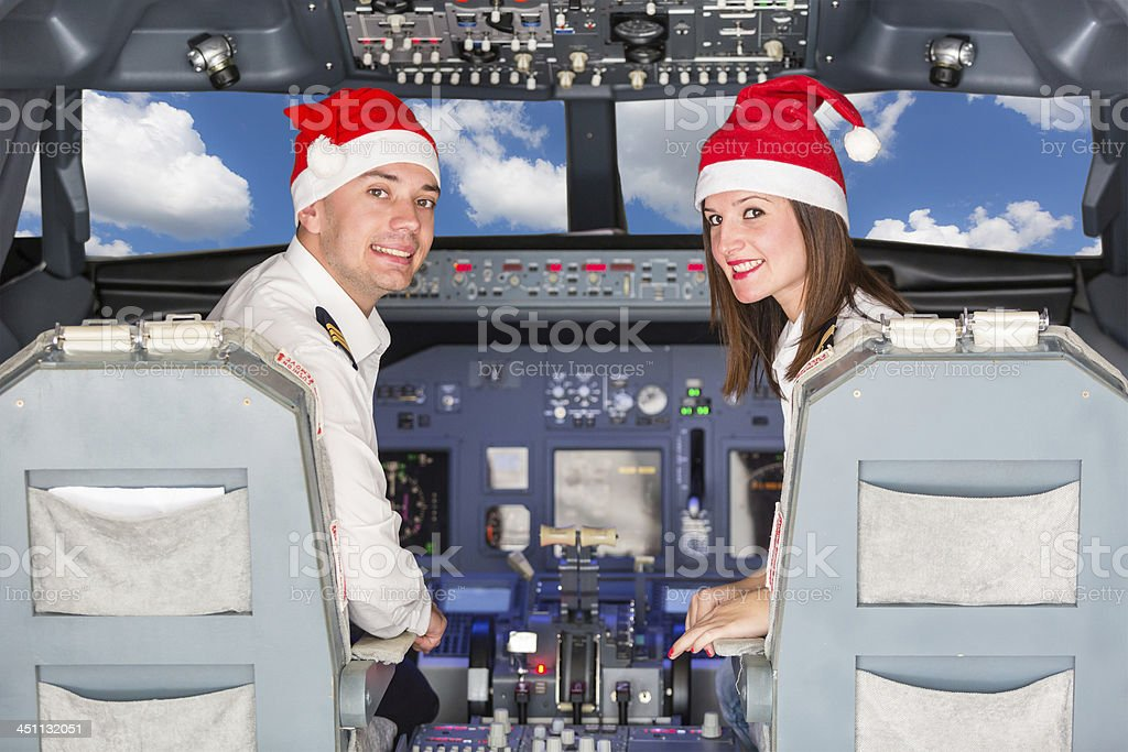 Pilots in the Cockpit with Santa Hat royalty-free stock photo