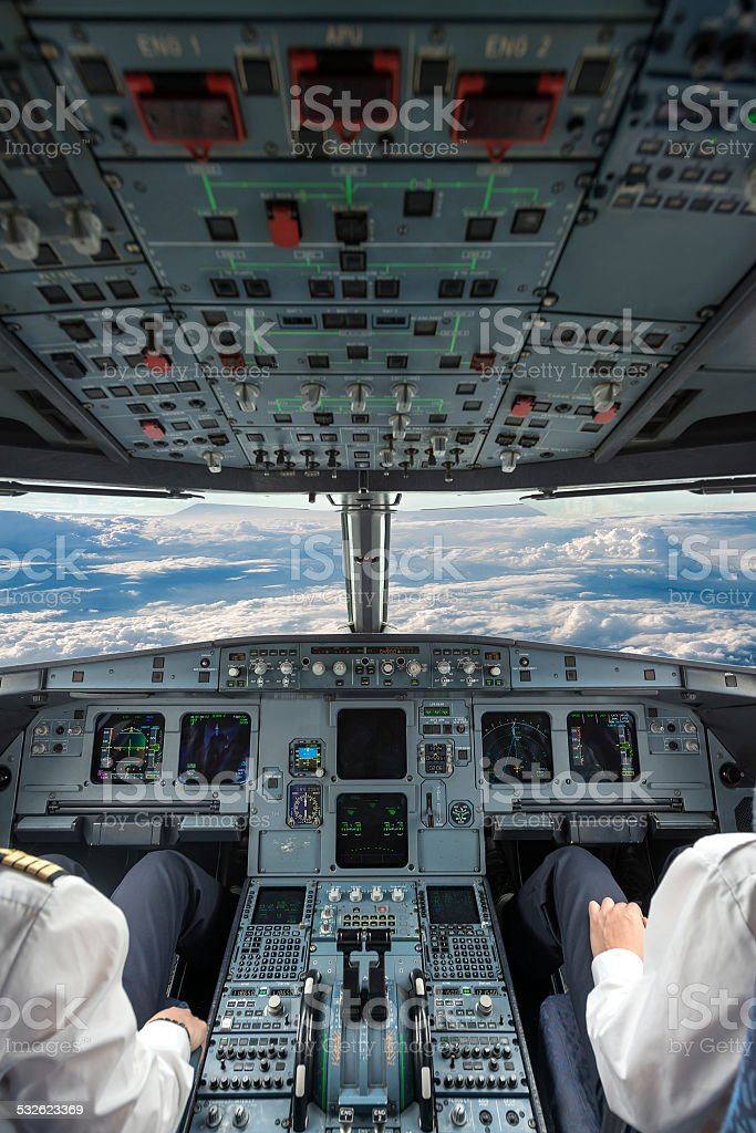 Pilots in the plane cockpit stock photo