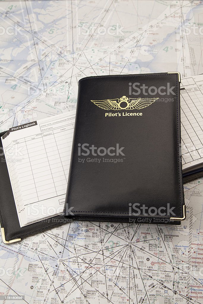Pilots license on a logbook royalty-free stock photo