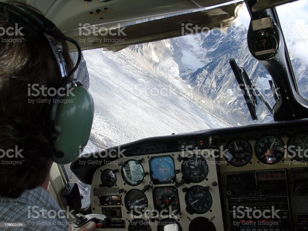 pilots view from plane cockpit flying over a glacier royalty-free stock photo