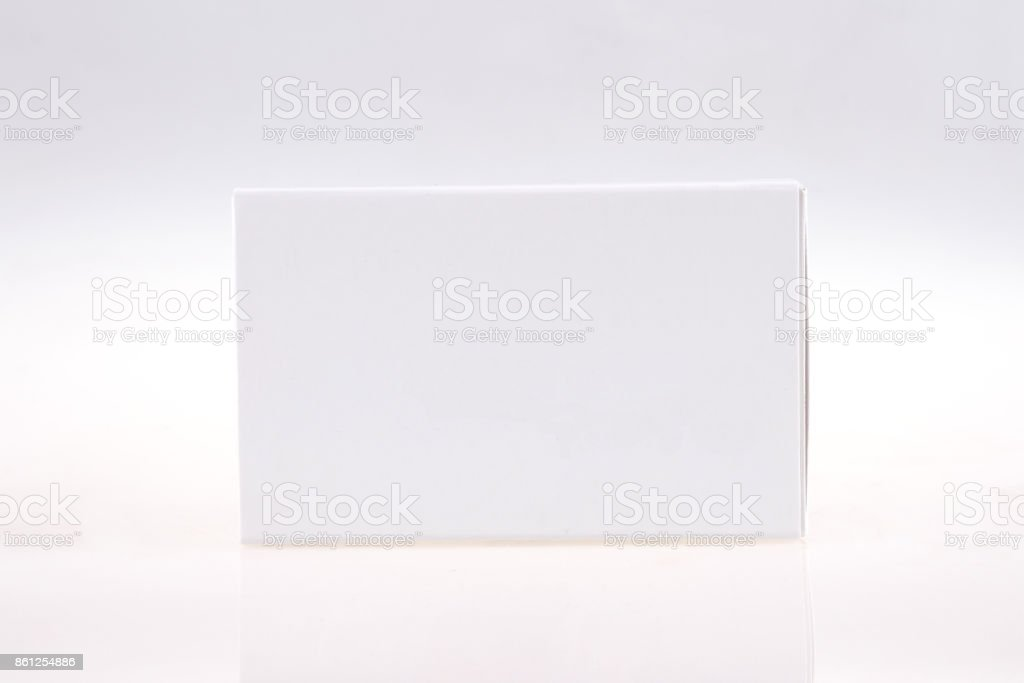 Pils or capsules carton package on gray background stock photo