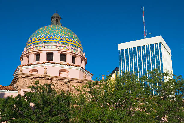 Pima County Courthouse and Tucson Downtown Pima County Courthouse landmark building with Tucson downtown buildings in the background. pima county stock pictures, royalty-free photos & images
